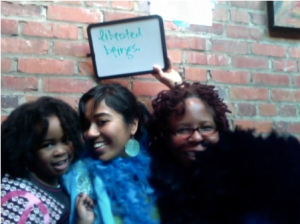 Liberated beings in boas at the MotherOurselves Bootcamp photobooth in Durham, NC!
